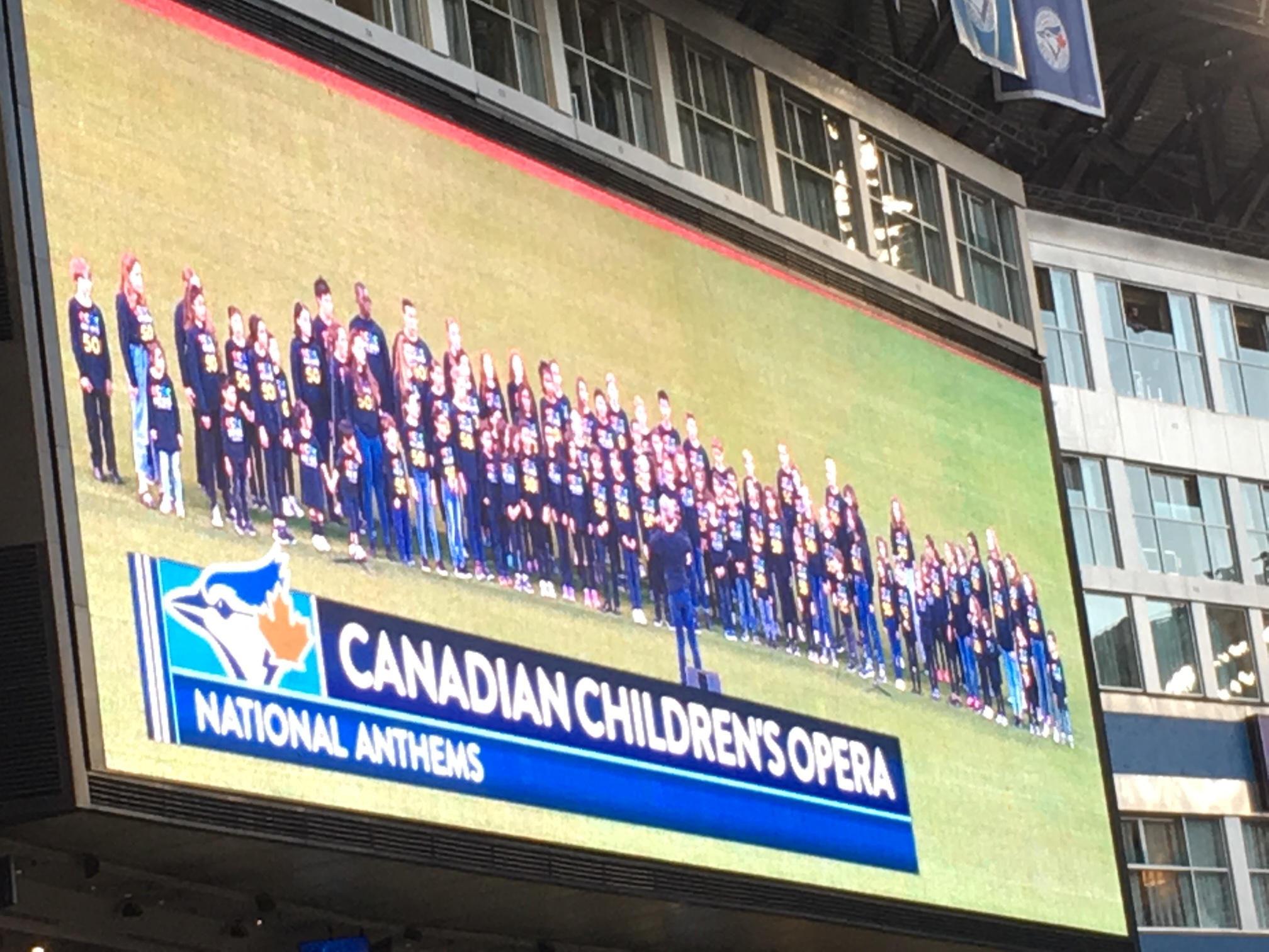 Children shown on large screen in Rogers Centre