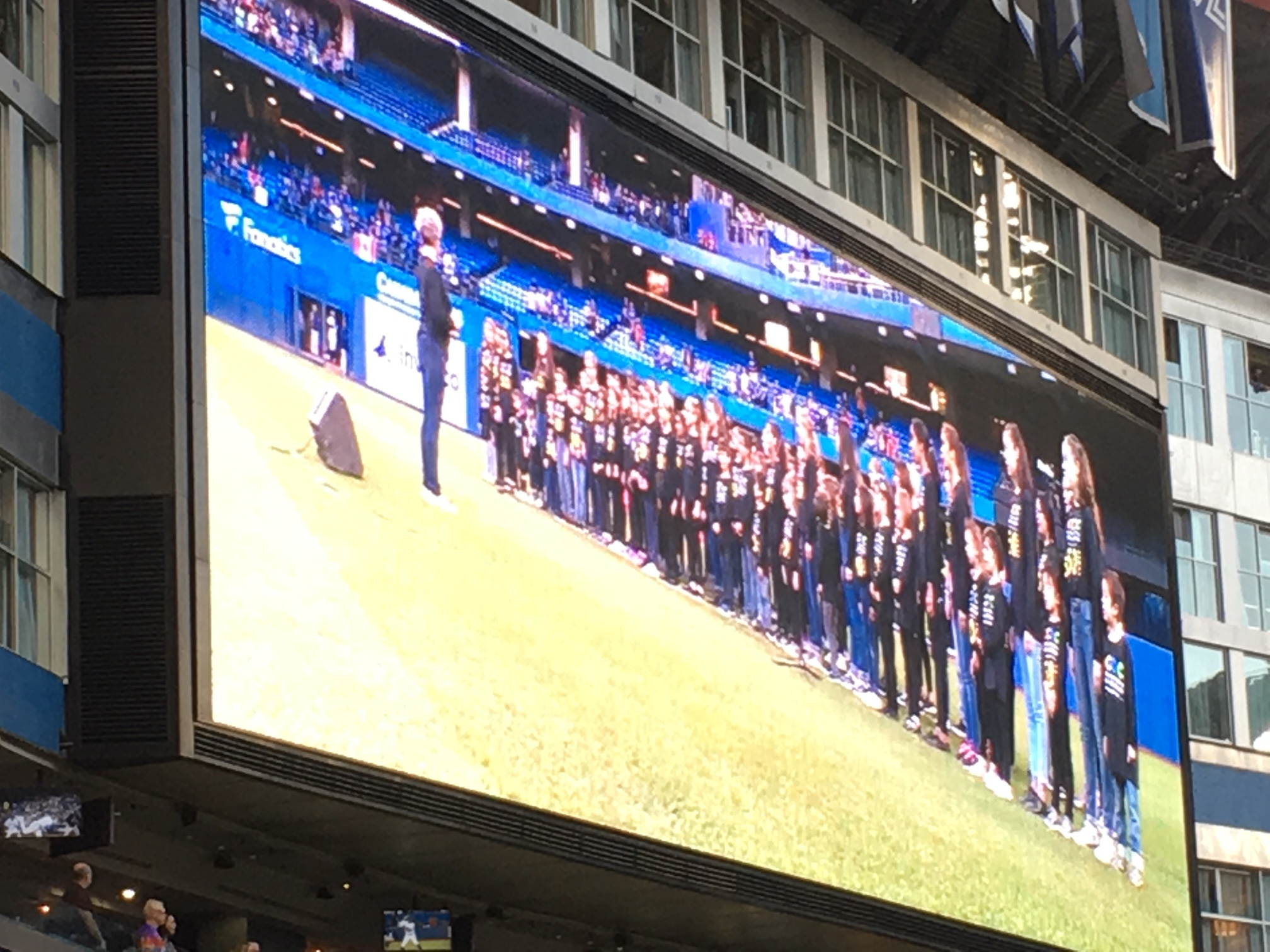 Choristers on large screen in Rogers Centre